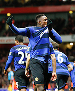 Picture by Andrew Tobin/Focus Images Ltd. 07710 761829. .21/01/12. Danny Welbeck (19) of Manchester United kisses his club badge after scoring the winning goal during the Barclays Premier League match between Arsenal and Manchester United at Emirates Stadium, London.