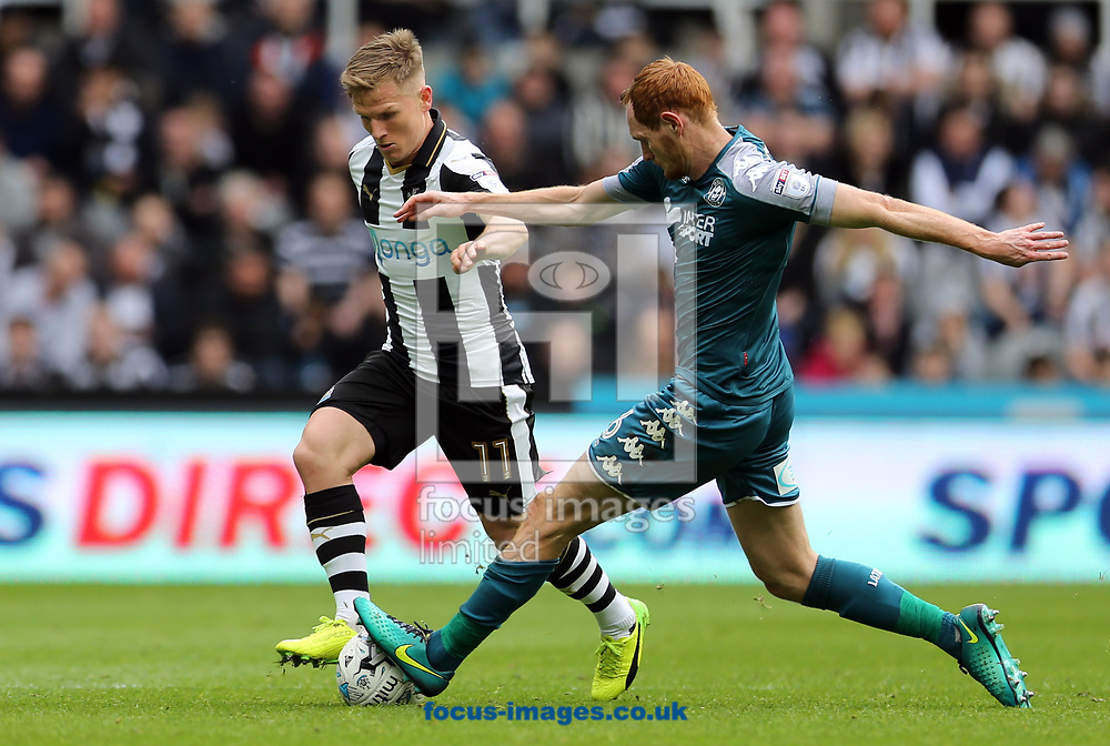 Matt Ritchie (l) of Newcastle United is tackled by Shaun MacDonald of Wigan Athletic during the Sky Bet Championship match at St. James's Park, Newcastle<br /> Picture by Simon Moore/Focus Images Ltd 07807 671782<br /> 01/04/2017