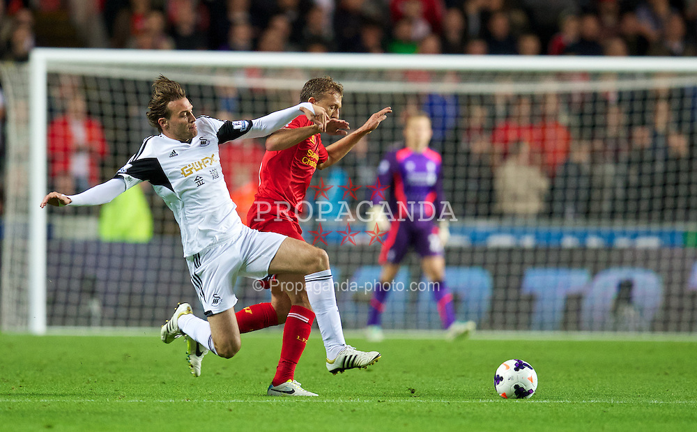 SWANSEA, WALES - Monday, September 16, 2013: Liverpool's Lucas Leiva in action against Swansea City's Miguel Perez Cuesta 'Michu' during the Premiership match at the Liberty Stadium. (Pic by David Rawcliffe/Propaganda)