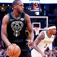 01 April 2018: Milwaukee Bucks forward Khris Middleton (22) drives past Denver Nuggets guard Torrey Craig (3) during the Denver Nuggets 128-125 victory over the Milwaukee Bucks, at the Pepsi Center, Denver, Colorado, USA.