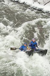 Richard Chaney and Julie Smith of Nashua make their way through a class IV rapid in Franklin during the 30th annual New Year's Day Winnipesaukee kayak run on Saturday, January 1, 2011.  (Alan MacRae/for the Monitor)