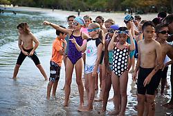 """Children in the 9-11 age group prepare for the swim segment of the triathalon.  """"Run, Bike, Swim"""" the Rotary Sunrise Kids Triathalon at Magens Bay.  St. Thomas, USVI.  11 April 2015.  © Aisha-Zakiya Boyd"""