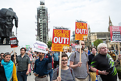 London, UK. 2 September, 2019. Drew Galdron (r), a Boris Johnson lookalike named Faux BoJo, joins hundreds of people attending a 'Stop The Coup' protest in Parliament Square following Prime Minister Boris Johnson's address to the nation outside 10 Downing Street to the effect that there will be a vote on a general election if MPs vote for a further delay to Brexit.