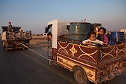 A Syrian family leaves the town of Taftanaz, Syria to find a safer area to spend the night . Resisdents say that each night they are bombarded with rockets from goverment forces . (Photo by Heidi Levine/Sipa Press).
