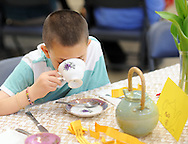 Nicholas Mento, 8 of Warminster, Pennsylvania sips tea during a Mother's Day Garden Tea Party, which was held indoors due to wet grounds,  Sunday May 8, 2016 at Churchville Nature Center in Churchville, Pennsylvania.  (Photo by William Thomas Cain)