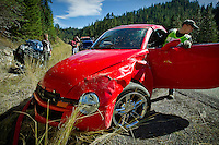 Shaun Thomas, with Merwin's Towing, helps maneuver a truck onto a lift while clearing an accident scene Wednesday on Fourth of July Pass. The two-car collision was caused by rocks sliding off the hillside.