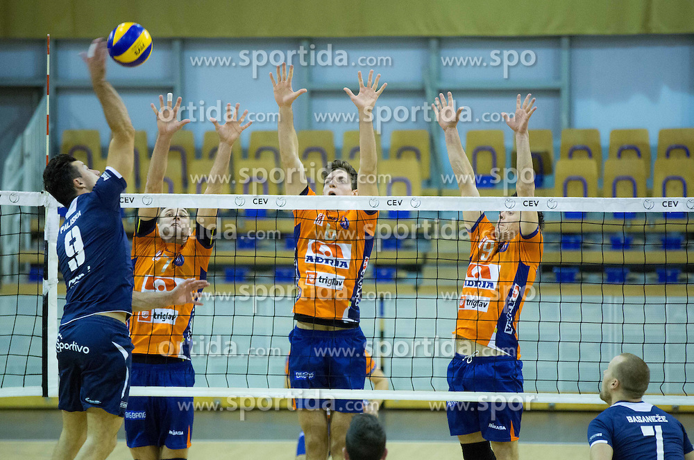 Andraz Paliska of Go Volley vs Danijel Pokersnik, Diko Puric and Matija Plesko of ACH during volleyball match between ACH Volley Ljubljana and GO Volley Nova Gorica in 11th Round of 1. DOL 2014/15, on November 13, 2014 in Hala Tivoli, Ljubljana, Slovenia. Photo by Vid Ponikvar / Sportida