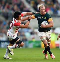 Schalk Burger of South Africa fends Shinya Makabe of Japan - Mandatory byline: Patrick Khachfe/JMP - 07966 386802 - 19/09/2015 - RUGBY UNION - Brighton Community Stadium - Brighton, England - South Africa v Japan - Rugby World Cup 2015 Pool B.