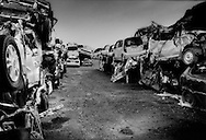 The lot is a repository for some of the hundreds of thousands of automobiles destroyed by the 11 March tsunami.  Most of the cars that were destroyed were not covered by insurance policies and were a total loss for their owners.  Ishinomaki, Miyagi Prefecture, Japan.