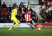 Brentford midfielder Alan Judge with a shot on goal during the Sky Bet Championship match between Brentford and Leeds United at Griffin Park, London, England on 26 January 2016. Photo by Matthew Redman.