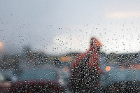 Person walking outside in the rain
