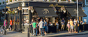 Customers enjoying warm weather at The Princess traditional London pub in Primrose Hill, London