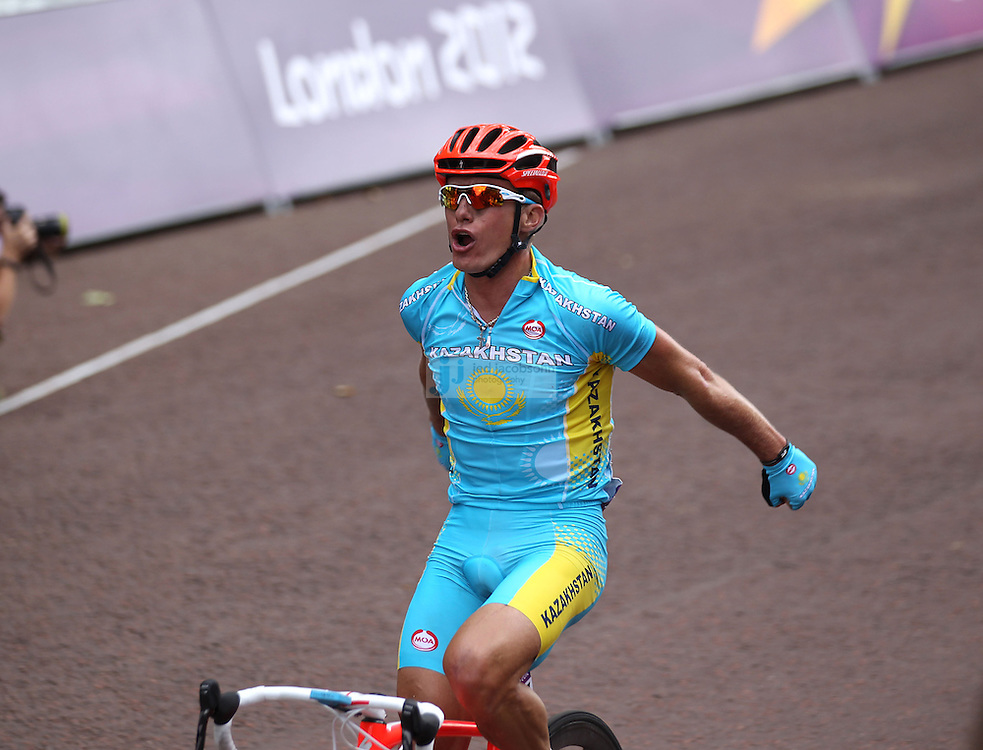Alexander Vinokourov of Kazakhstan celebrates after winning the gold medal in the Olympic Cycling men's road race during day 1 of the Olympic Games London, 28 Jul 2012..(Jed Jacobsohn/for The New York Times)....