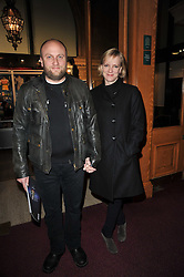 Actress HERMIONE NORRIS and her husband SIMON WHEELER at the opening night of Totem by Cirque du Soleil held at The Royal Albert Hall, London on 5th January 2011.