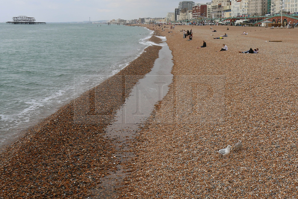 © Licensed to London News Pictures. 10/09/2014. Brighton, UK. Wednesday September 10th 2014 lunchtime on Brighton Beach. The weather is expected to be cloudy with temperatures expected to reach around the 17C in Brighton and the South Coast. Photo credit : Hugo Michiels/LNP