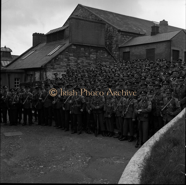 20/06/1961<br /> 06/20/1961<br /> 20 June 1961<br /> The 35th Battalion prepare to leave for the Congo on a peacekeeping mission with the UN. A group shot of the troops prior to leaving for the Congo from Collins Barracks?, Dublin.
