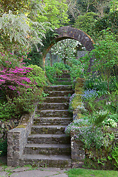 Steps leading up through arch from main garden to vegetable garden