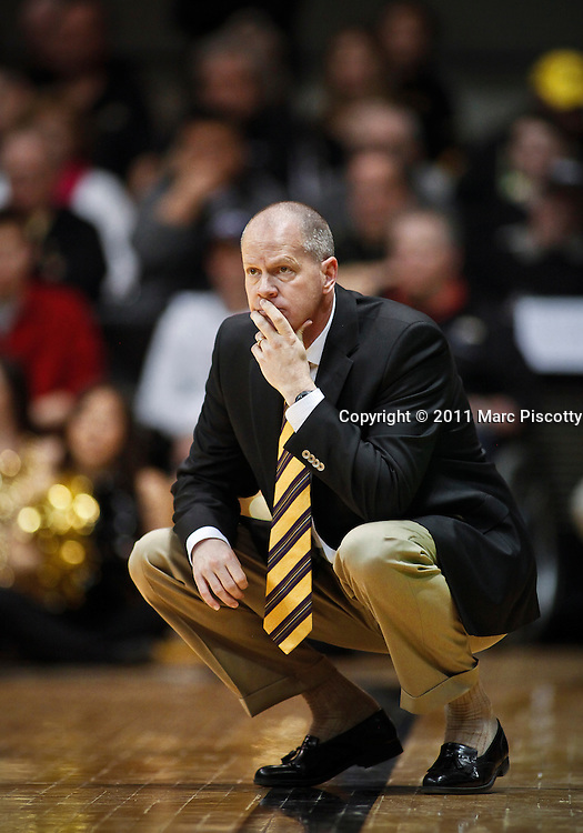 SHOT 2/26/11 3:13:00 PM - Colorado head basketball coach Tad Boyle on the sidelines coaching against Texas during their regular season Big 12 basketball game at the Coors Events Center in Boulder, Co. Colorado upset the fifth ranked Texas 91-89. (Photo by Marc Piscotty / © 2011)