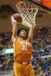 Feb 20, 2017; Morgantown, WV, USA; Texas Longhorns forward Jarrett Allen (31) dunks the ball during the first half against the West Virginia Mountaineers at WVU Coliseum. Mandatory Credit: Ben Queen-USA TODAY Sports