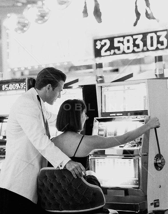 Young couple gambling at slot machine in Las Vegas