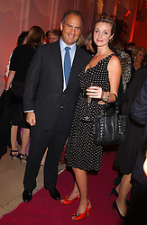 Actress ELIZE DU TOIT and CHARLES FINCH at a 'A Night in Cartier Paradise' to celebrate a new collection of jewellery by Cartier, held at The orangery, Kensington Palace, London W8 on 25th October 2005.<br /><br />NON EXCLUSIVE - WORLD RIGHTS
