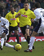 28/02/2004  -  Nationwide Div 1 Watford v Wimbledon.Scott Fitgerald [21] runs through the gap.