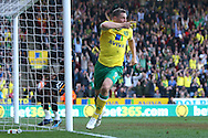 Picture by Paul Chesterton/Focus Images Ltd.  07904 640267.24/03/12.Grant Holt of Norwich scores his sides 1st goal and celebrates during the Barclays Premier League match at Carrow Road Stadium, Norwich.