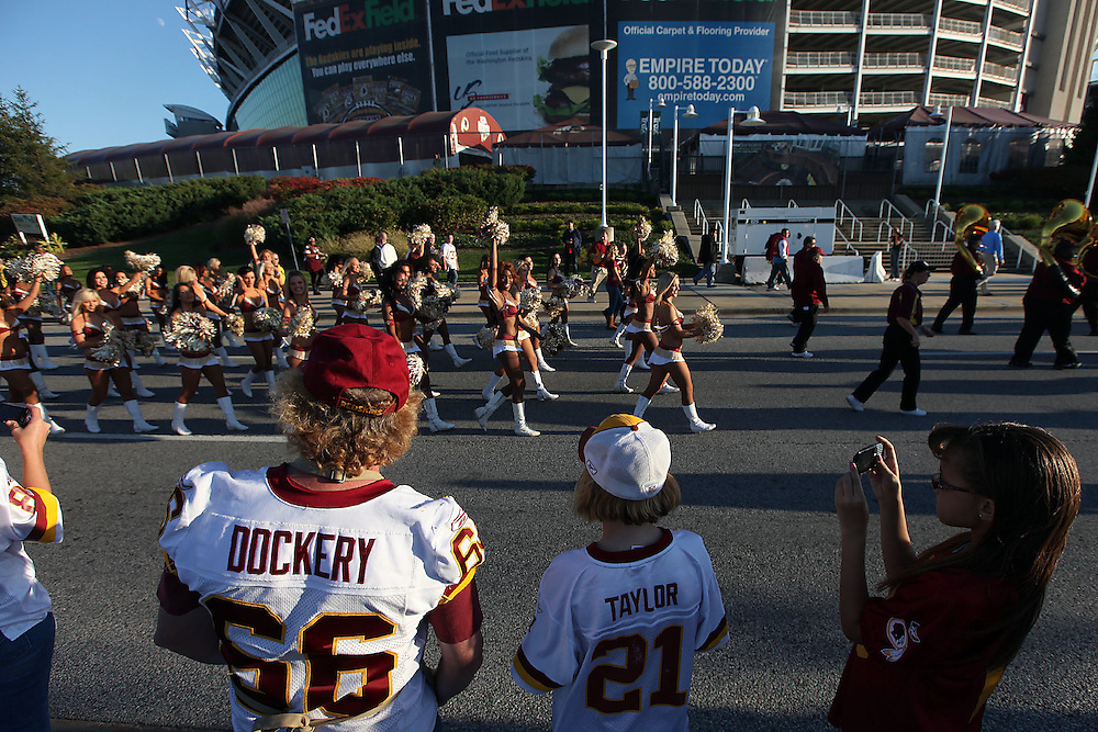 """Washington., Oct. 17, 2010 -Redskins vs. Colts  -  Fans watch as the Redskins cheerleaders walk by during a """"Homecoming"""" parade at FedEx Field in Landover, Md., on Sunday, Oct. 17, 2010. (Photo by Jay Westcott/TBD)"""