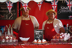 © London News Pictures. 12/05/2016. Windsor, UK. Strawberries and cream being sold on the first day of the 2016 Royal Windsor Horse Show, held in the grounds of Windsor Castle in Berkshire, England. The opening day of the event was cancelled due to heavy rain and waterlogged grounds. This years event is part of HRH Queen Elizabeth II's 90th birthday celebrations.  Photo credit: Ben Cawthra/LNP