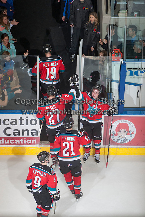 KELOWNA, CANADA - NOVEMBER 1:  The Kelowna Rockets exit the ice and celebrate the win against the Kamloops Blazers at the Kelowna Rockets on November 1, 2012 at Prospera Place in Kelowna, British Columbia, Canada (Photo by Marissa Baecker/Shoot the Breeze) *** Local Caption ***