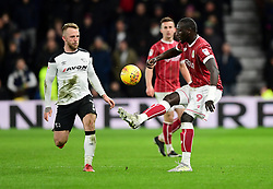 Famara Diedhiou of Bristol City lifts the ball over Johnny Russell of Derby County  - Mandatory by-line: Joe Meredith/JMP - 19/01/2018 - FOOTBALL - Pride Park Stadium - Derby, England - Derby County v Bristol City - Sky Bet Championship