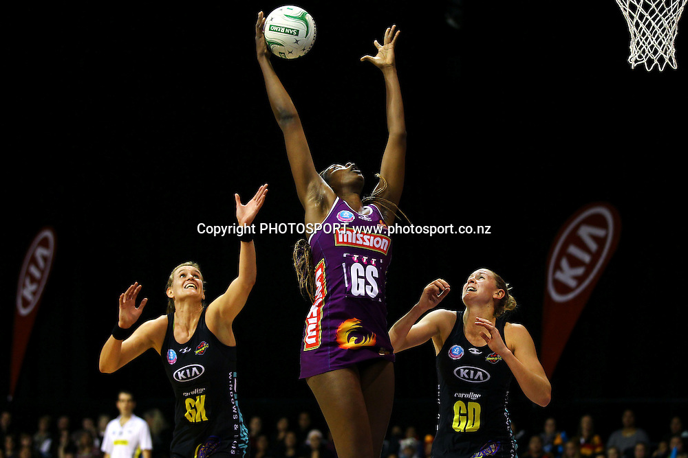 Firebirds' Romelda Aiken goes for the high entry ball. ANZ Netball Championship, Minor Semifinal, Waikato/Bay of Plenty Magic v Queensland Firebirds, Claudelands Arena, Hamilton, New Zealand. Sunday 30th June 2013. Photo: Anthony Au-Yeung / photosport.co.nz