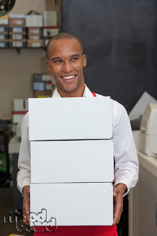 Cheerful worker holding containers