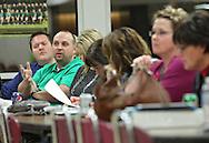 Brandon Kirchhoff, 2nd grade teacher at Madison Elementary School, talks at an Association Representation Assembly by the Cedar Rapids Education Association at Kennedy High School in Cedar Rapids on Wednesday evening, November 14, 2012.