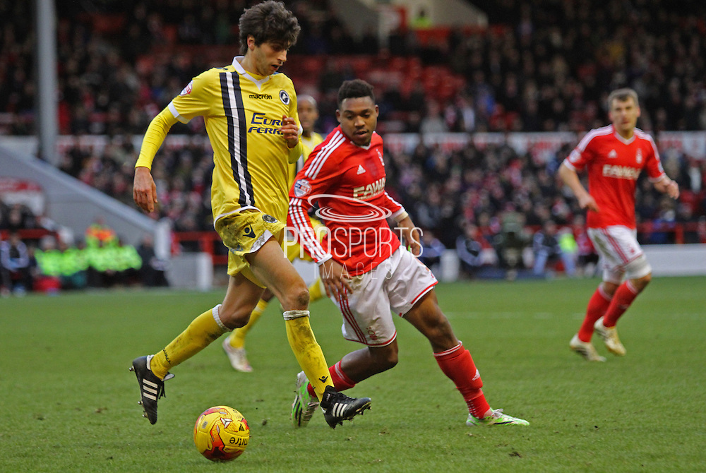 Diego Fabbrini and Britt Assombalonga during the Sky Bet Championship match between Nottingham Forest and Millwall at the City Ground, Nottingham, England on 31 January 2015. Photo by Jodie Minter.