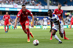 Olamide Shodipo of Queens Park Rangers goes past Lloyd Jones of Swindon Town - Mandatory by-line: Robbie Stephenson/JMP - 10/08/2016 - FOOTBALL - Loftus Road - London, England - Queens Park Rangers v Swindon Town - EFL League Cup