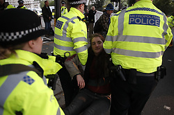 © Licensed to London News Pictures. 07/10/2019. London, UK. Extinction Rebellion protestors are surrounded by police as they arrest some activists on Embankment near the Ministry of Defence in central London . Activists will converge on Westminster blockading roads in the area for at least two weeks calling on government departments to 'Tell the Truth' about what they are doing to tackle the Emergency. Photo credit: Peter Macdiarmid/LNP