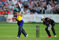 Hamish Marshall of Gloucestershire plays a shot past Craig Kieswetter of Somerset - Photo mandatory by-line: Dan Mullan/JMP - 07966 386802 - 16/05/2014 - SPORT - CRICKET - County Cricket Ground - Gloucester Cricket v Somerset Cricket - T20