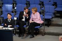 13 FEB 2009, BERLIN/GERMANY:<br /> Guido Westerwelle (L), FDP Bundesvorsitzender, und Angela Merkel (R), CDU, Bundeskanzlerin, im Gespraech, waehrend der Bundestagsdebatte zum zweiten Konjunkturpaket zur Sicherung von Beschaeftigung und Stabilitaet in Deutschland, Plenum, Deutscher Bundestag<br /> IMAGE: 20090213-01-070<br /> KEYWORDS: Gespräch