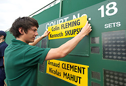 LONDON, ENGLAND - Thursday, June 24, 2010: A groundman places the players name plate of Kenneth Skupski and Colin Flemming on the scoreboard before the Gentlemen's Doubles 1st Round match on day four of the Wimbledon Lawn Tennis Championships at the All England Lawn Tennis and Croquet Club. (Pic by David Rawcliffe/Propaganda)