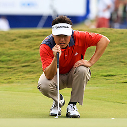 2009 April 26: Charley Wi of Westlake Village, CA lines up a putt on the 18th hole during the final round of the Zurich Classic of New Orleans PGA Tour golf tournament played at TPC Louisiana in Avondale, Louisiana.