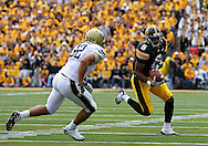 September 17, 2011: Iowa Hawkeyes wide receiver Keenan Davis (6) tries to get around Pittsburgh Panthers linebacker Tristan Roberts (32) during the first half of the game between the Iowa Hawkeyes and the Pittsburgh Panthers at Kinnick Stadium in Iowa City, Iowa on Saturday, September 17, 2011. Iowa defeated Pittsburgh 31-27.