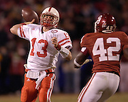 University of Nebraska quarterback Zac Taylor throws down field under pressure form Oklahoma's Rufus Alexander (42), during the Big 12 Championship game at Arrowhead Stadium in Kansas City, Missouri, December 2, 2006.  Oklahoma beat Nebraska 21-7.<br />