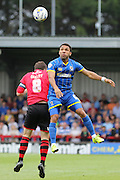 Andy Barcham and Matt Oakley during the Sky Bet League 2 match between AFC Wimbledon and Exeter City at the Cherry Red Records Stadium, Kingston, England on 29 August 2015. Photo by Stuart Butcher.