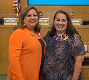 Luz Lopez, left, and Siomara Saenz-Phillips, right, pose for a photograph during the Board of Trustees meeting, June 11, 2015.
