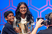 Snigdha Nandipati, 14, of San Diego, CA, is hugged by her brother, Sujan, 10, after she won the 85th Annual Scripps National Spelling Bee at the Gaylord National Resort & Convention Center in National Harbor, Md., near Washington, D.C. Snigdha won $30,000 in cash, a trophy, a $2,500 savings bond, a $5,000 scholarship, $2,600 in reference works from the Encyclopedia Britannica and an online language course.
