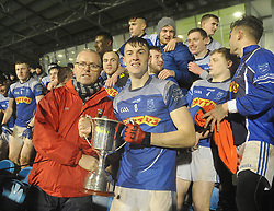 Claremorris U21 A 2018 County Champions<br />James McCormack accecpts Mayo U21 Cup from Seamus Touhy Vice Chairman Mayo GAA.