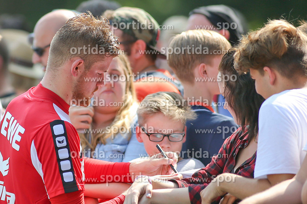 16.07.2015, Geissbockheim, Koeln, GER, 1. FBL, 1. FC Koeln, Training, im Bild Torwart Timo Horn (1. FC Koeln #1) gibt Autogramme // during a practice session of German Bundesliga Club 1. FC Cologne at the Geissbockheim in Koeln, Germany on 2015/07/16. EXPA Pictures &copy; 2015, PhotoCredit: EXPA/ Eibner-Pressefoto/ Schueler<br /> <br /> *****ATTENTION - OUT of GER*****