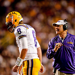 November 10, 2012; Baton Rouge, LA, USA; LSU Tigers head coach Les Miles talks to quarterback Zach Mettenberger (8) as he walks back to the huddle during the second half of a game against the Mississippi State Bulldogs at Tiger Stadium.  LSU defeated Mississippi State 37-17. Mandatory Credit: Derick E. Hingle-US PRESSWIRE