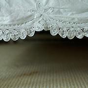 Wrinkled bedlace  and stained carpet in our master bedroom, Maine.